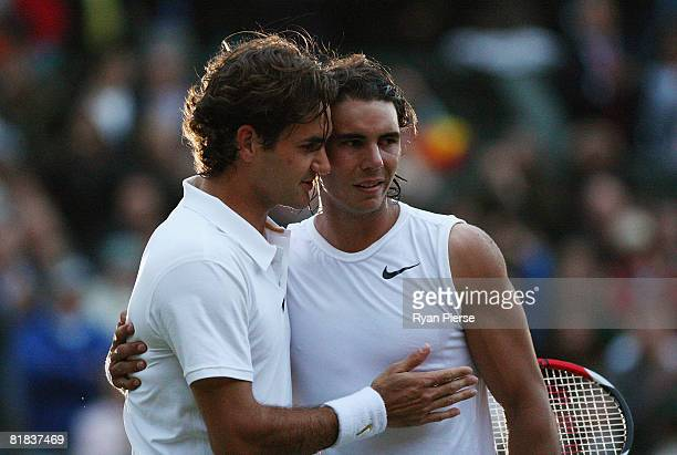 Roger Federer of Switzerland congratulates Rafael Nadal of Spain in winning match point and the Championship during the men's singles Final on day...