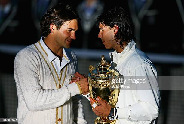 Roger Federer of Switzerland congratulates Rafael Nadal of Spain in winning the Championship trophy during the men's singles Final on day thirteen of...