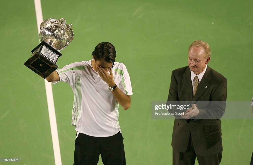 Roger Federer of Switzerland cries as he collects the trophy after victory in his Men's Singles Final match against Marcos Baghdatis of Cyprus during day fourteen of the Australian Open at Melbourne Park January 29, 2006 in Melbourne, Australia.