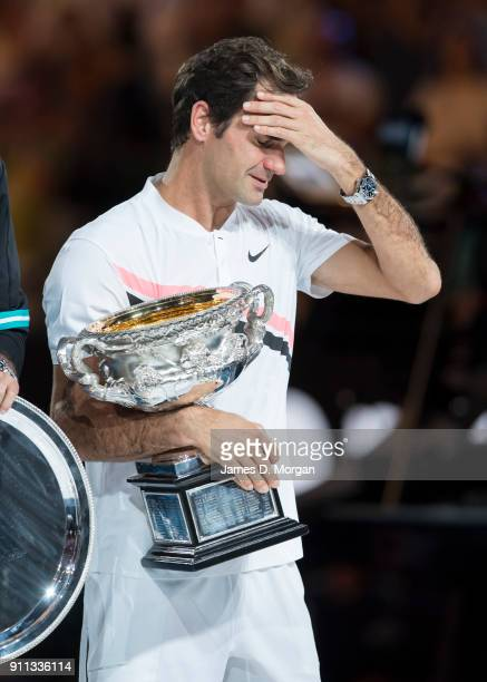 Roger Federer of Switzerland cries with the trophy after winning the men's singles tournament against Marin Cilic of Croatia on day 14 of the 2018...