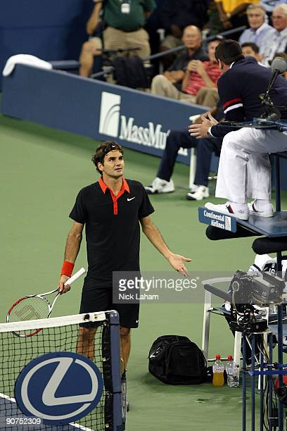 Roger Federer of Switzerland disputes a call in the fourth set tiebreak to chair judge Jake Garner during the Men�s Singles final on day fifteen of...