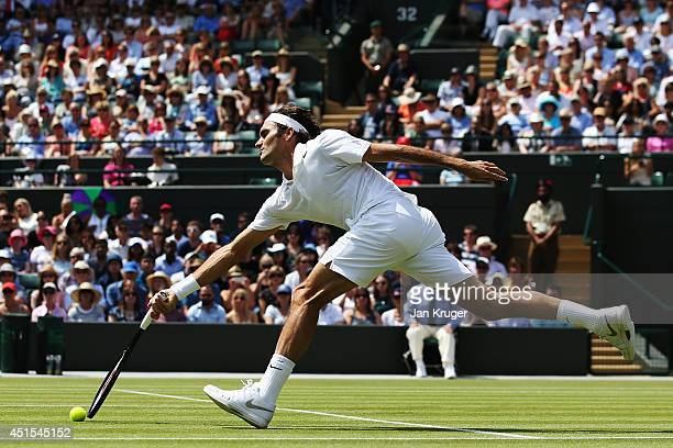 Roger Federer of Switzerland during his Gentlemen's Singles fourth round match against Tommy Robredo of Spain on day eight of the Wimbledon Lawn...