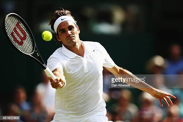 Roger Federer of Switzerland during his Gentlemen's Singles quarterfinal match against Stan Wawrinka of Switzerland on day nine of the Wimbledon Lawn...