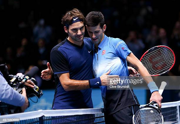 Roger Federer of Switzerland embraces Novak Djokovic of Serbia after his straight sets victory during day three of the Barclays ATP World Tour Finals...