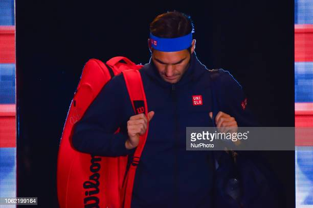 Roger Federer of Switzerland enters the court during his round robin match against Kevin Anderson of South Africa during Day Five of the Nitto ATP...