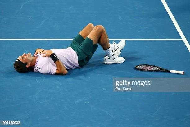 Roger Federer of Switzerland entertains the spectators during the mixed doubles match partnered with Belinda Bencic against Jack Sock and CoCo...