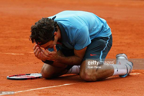 Roger Federer of Switzerland falls to his knees as he celebrates victory during the Men's Singles Final match against Robin Soderling of Sweden on...