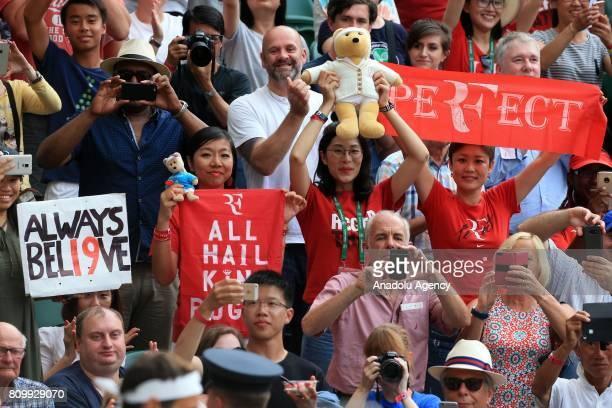 Roger Federer of Switzerland fans cheer as he walks onto Centre Court for his match against Dusan Lajovic of Serbia on day four of the 2017 Wimbledon...