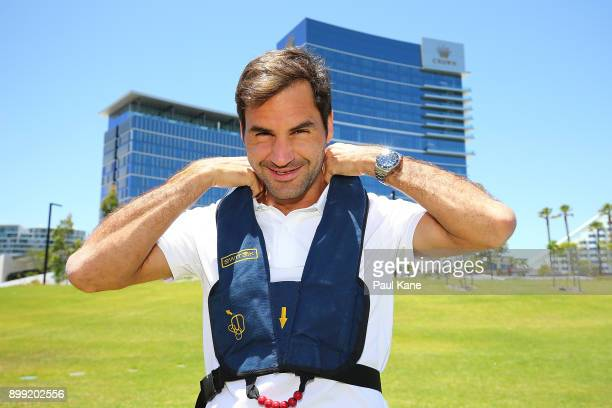 Roger Federer of Switzerland fits his life jacket before a helicopter flight to Rottnest Island ahead of the 2018 Hopman Cup on December 28 2017 in...