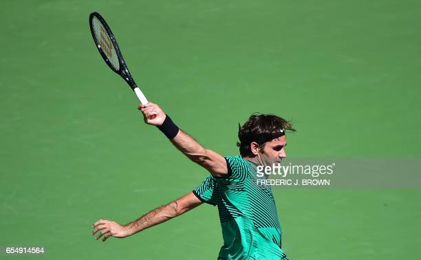 TOPSHOT Roger Federer of Switzerland follows through on his backhand return to Jack Sock of the US in their men's semifinal ATP Indian Wells Masters...