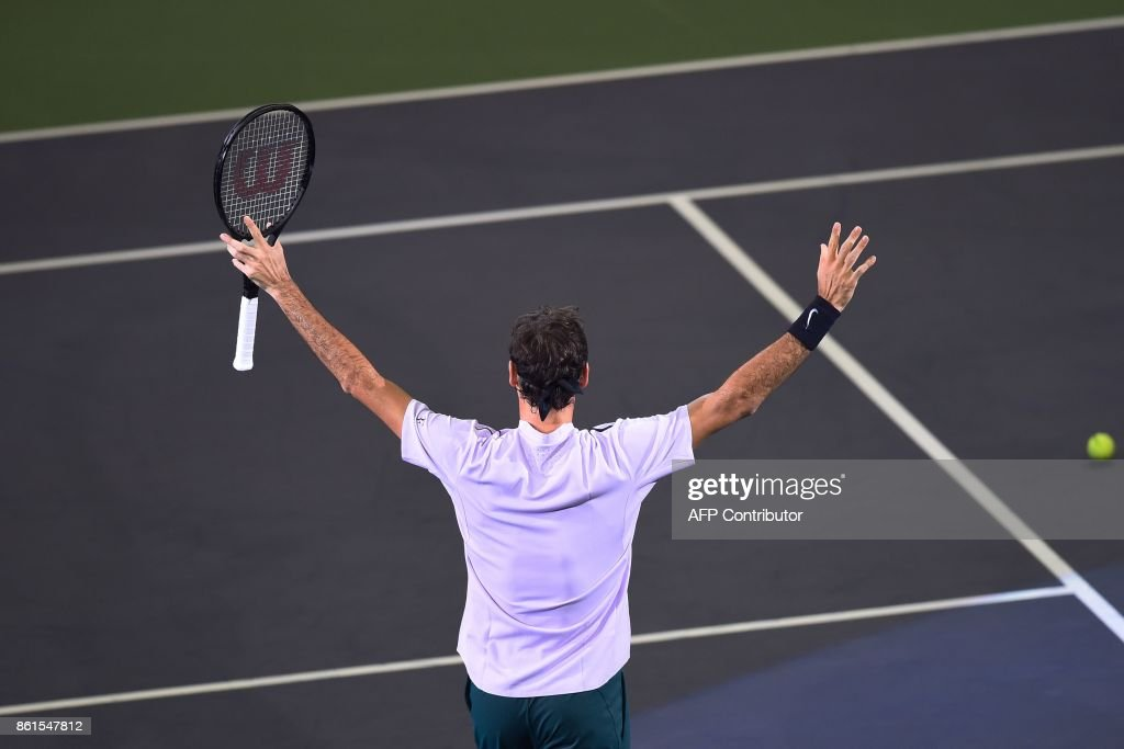 Roger Federer of Switzerland gestures after beating Rafael Nadal of Spain in their men's singles final match at the Shanghai Masters tennis tournament in Shanghai on October 15, 2017. / AFP PHOTO / Chandan KHANNA