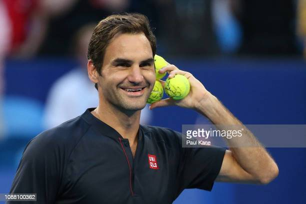 Roger Federer of Switzerland gestures to the spectators before hitting signed tennis balls into the stands during day two of the 2019 Hopman Cup at...