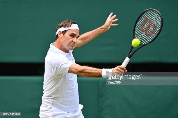 Roger Federer of Switzerland hits a backhand against Hubert Hurkacz of Poland in the quarter finals of the gentlemen's singles during Day Nine of The...
