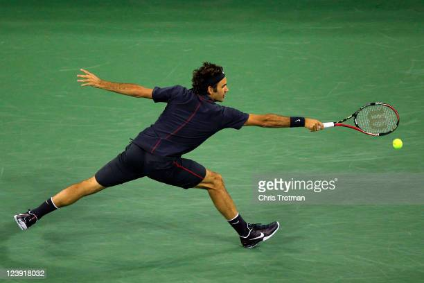 Roger Federer of Switzerland hits a backhand against Juan Monaco of Argentina during Day Eight of the 2011 US Open at the USTA Billie Jean King...