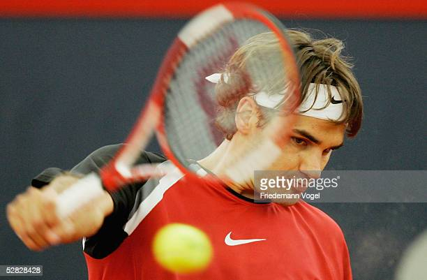 Roger Federer of Switzerland hits a backhand during his match against Richard Gasquet of France during the final of the Masters Series Hamburg at...