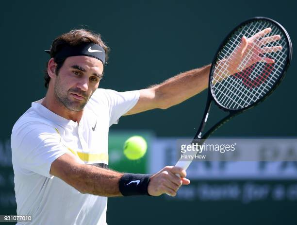 Roger Federer of Switzerland hits a backhand in his match against Filip Krajinovic of Serbia during the BNP Paribas Open at the Indian Wells Tennis...