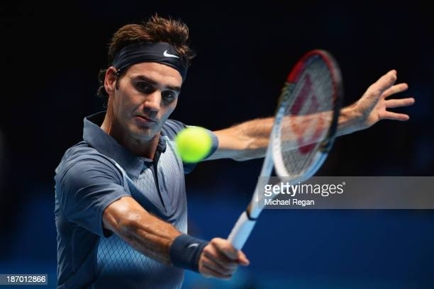 Roger Federer of Switzerland hits a backhand in his men's singles match against Novak Djokovic of Serbia during day two of the Barclays ATP World...