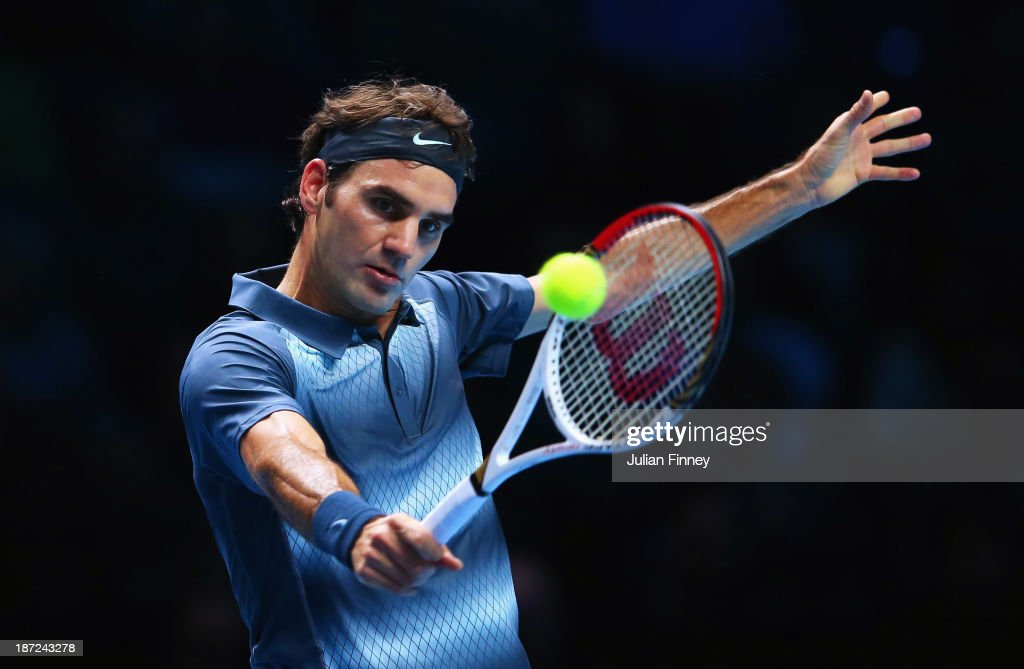 Roger Federer of Switzerland hits a backhand in his men's singles match against Richard Gasquet of France during day four of the Barclays ATP World Tour Finals at O2 Arena on November 7, 2013 in London, England.