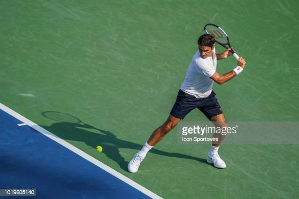 Roger Federer of Switzerland hits a backhand shot in the championship match with Novak Djokovic of Serbia during the Western Southern Open singles...