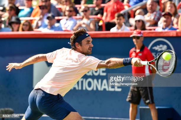 Roger Federer of Switzerland hits a backhanded return against Robin Haase of Netherlands during day nine of the Rogers Cup presented by National Bank...