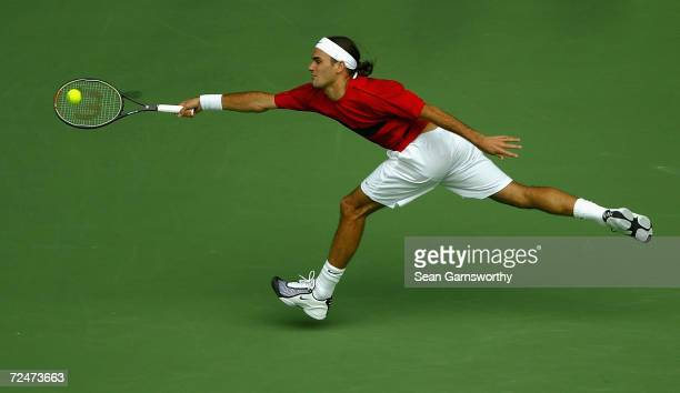 Roger Federer of Switzerland hits a forehand against Marat Safin of Russia during the Mens Singles Final during day fourteen of the Australian Open...