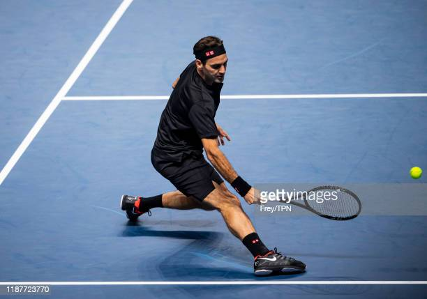 Roger Federer of Switzerland hits a forehand against Novak Djokovic of Serbia during Day Five of the Nitto ATP World Tour Finals at The O2 Arena on...
