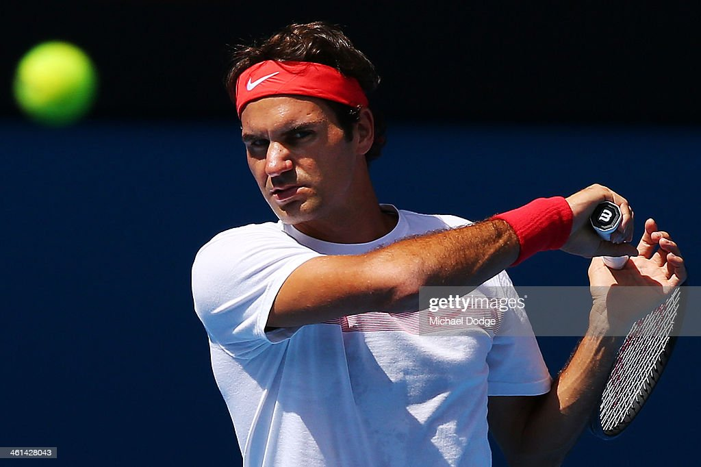 Roger Federer of Switzerland hits a forehand ahead of the 2014 Australian Open at Melbourne Park on January 9, 2014 in Melbourne, Australia.