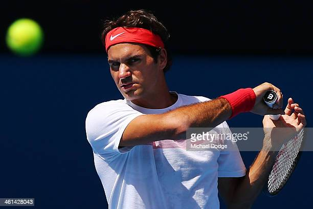 Roger Federer of Switzerland hits a forehand ahead of the 2014 Australian Open at Melbourne Park on January 9 2014 in Melbourne Australia