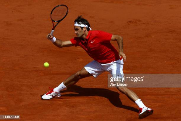 Roger Federer of Switzerland hits a forehand during the men's singles round four match between Stanislas Wawrinka of Switzerland and Roger Federer of...