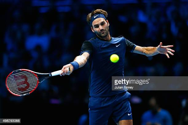 Roger Federer of Switzerland hits a forehand during the men's singles final against Novak Djokovic of Serbia on day eight of the Barclays ATP World...