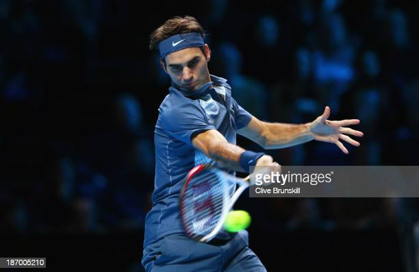 Roger Federer of Switzerland hits a forehand in his men's singles match against Novak Djokovic of Serbia during day two of the Barclays ATP World...