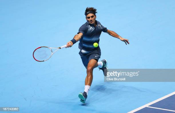Roger Federer of Switzerland hits a forehand in his men's singles match against Richard Gasquet of France during day four of the Barclays ATP World...