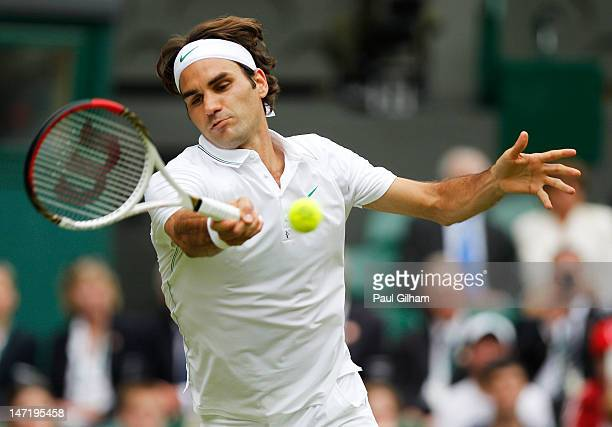 Roger Federer of Switzerland hits a forehand return during his Gentlemen's Singles second round match against Fabio Fognini of Italy on day three of...