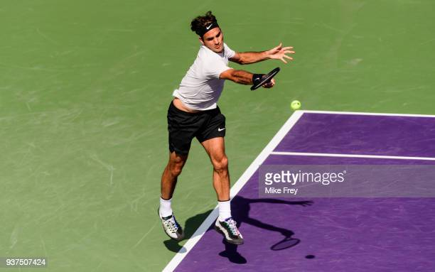 Roger Federer of Switzerland hits a forehand to Thanasi Kokkinakis of Australia on Day 6 of the Miami Open Presented by Itau at Crandon Park Tennis...