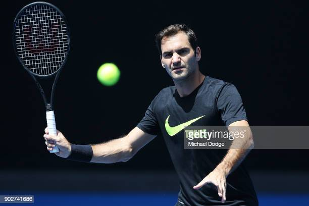 Roger Federer of Switzerland hits a forehand volley during a practice session ahead of the 2018 Australian Open at Melbourne Park on January 9 2018...