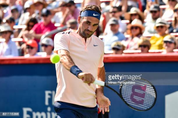 Roger Federer of Switzerland hits a return against Alexander Zverev of Germany during day ten of the Rogers Cup presented by National Bank at Uniprix...