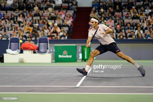 Roger Federer of Switzerland hits a return against Borna Coric of Croatia during their Singles - Semifinals match of the 2018 Rolex Shanghai Masters...
