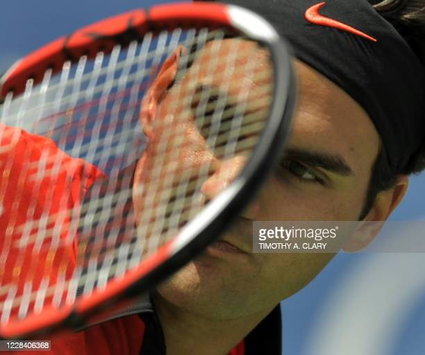 Roger Federer of Switzerland hits a return against Devin Britton of the US during a US Open first round match at the USTA Billie Jean King National...