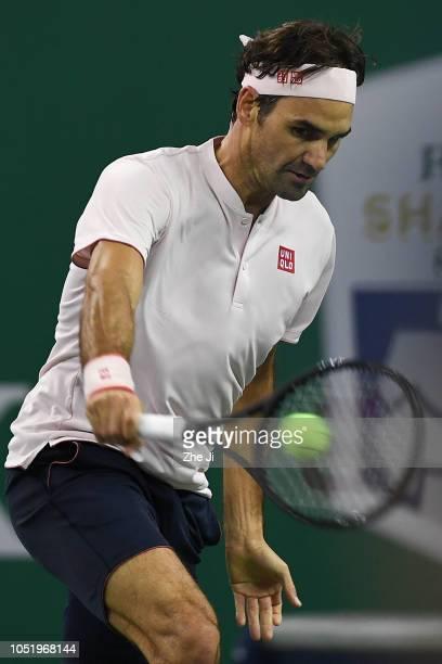 Roger Federer of Switzerland hits a return against Kei Nishikori of Japan during the 2018 Rolex Shanghai Masters Men's Singles - Quarterfinals match...