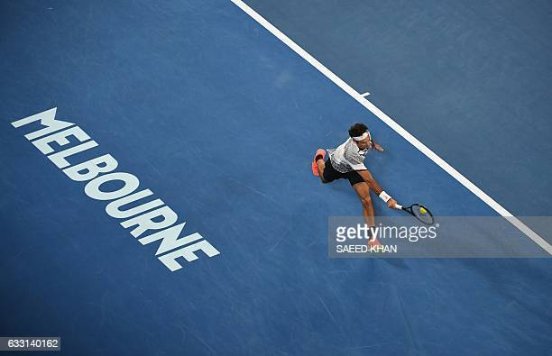 Roger Federer of Switzerland hits a return against Rafael Nadal of Spain during the men's singles final on day 14 of the Australian Open tennis...