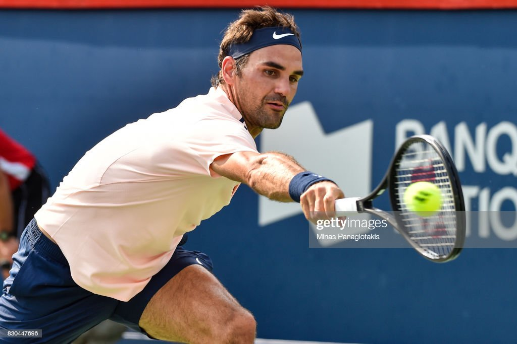 Roger Federer of Switzerland hits a return against Roberto Bautista Agut of Spain during day eight of the Rogers Cup presented by National Bank at Uniprix Stadium on August 11, 2017 in Montreal, Quebec, Canada.
