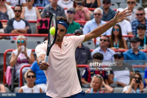Roger Federer of Switzerland hits a return against Robin Haase of Netherlands during day nine of the Rogers Cup presented by National Bank at Uniprix...