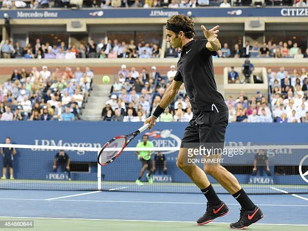 Roger Federer of Switzerland hits a return to Gael Monfils of France during their US Open 2014 men's singles quarterfinals match at the USTA Billie...
