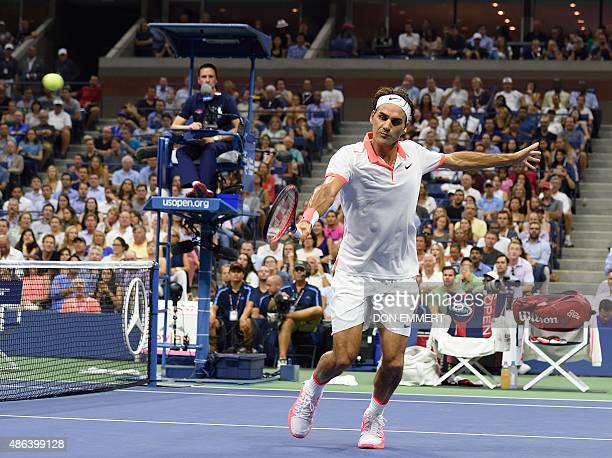 Roger Federer of Switzerland hits a return to Steve Darcis of Belgium during the 2015 US Open men's singles round two match at the USTA Billie Jean...