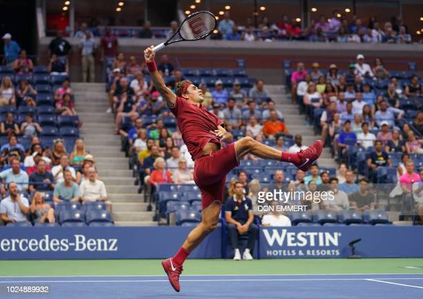 TOPSHOT Roger Federer of Switzerland hits a return to Yoshihito Nishioka of Japan during their 2018 US Open men's match August 28 2018 in New York