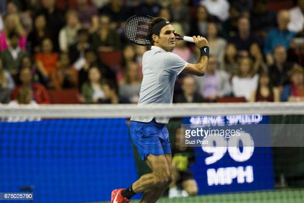 Roger Federer of Switzerland hits a serve to John Isner of the United States at the Match For Africa 4 exhibition match at KeyArena on April 29, 2017...