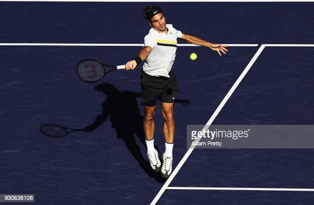 Roger Federer of Switzerland hits a shot during his match against Federico Delbonis of Argentina during the BNP Paribas Open at the Indian Wells...