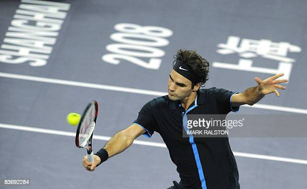 Roger Federer of Switzerland hits a volley against Andy Murray of Britain in their men's singles match on the sixth day of the ATP Masters Cup tennis...