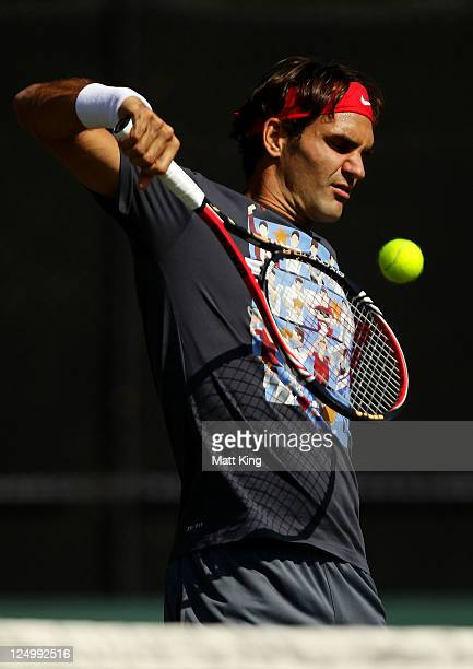 Roger Federer of Switzerland hits a volley during a practice session ahead of the Davis Cup World Group Playoff Tie between Australia and Switzerland...