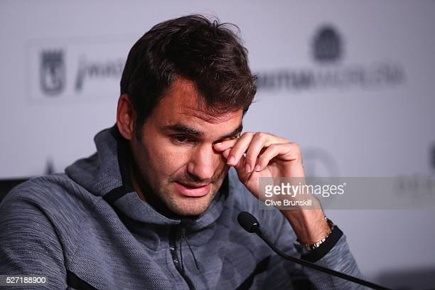 Roger Federer of Switzerland holds a press conference to annouce his withdrawal due to a back injury before his first match during day three of the...